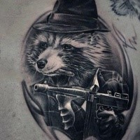 Amazing looking black ink scapular tattoo of raccoon mafioso with Tommy gun