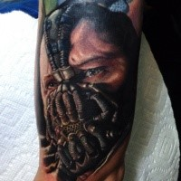 Amazing looking colored arm tattoo of Bane portrait