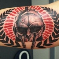 Amazing looking colored biceps tattoo of gladiators helmet with ornaments