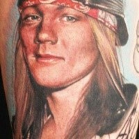 Amazing looking colored portrait style shoulder tattoo of famous rock star