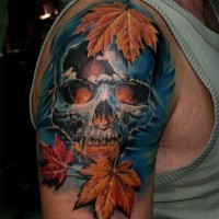 Amazing looking corrupted vampire skull tattoo on shoulder stylized with natural looking leaves