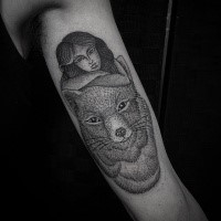 Amazing old looking biceps tattoo of big fox with woman