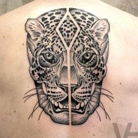 Amazing symmetrical designed upper back tattoo of leopard head with human skull by Valentin Hirsch
