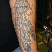 American native colored dream catcher with feather tattoo on sleeve