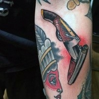 American traditional Indian woman chef and ancient gun colored forearm tattoo
