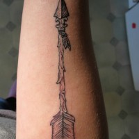 Ancient arrow tattoo on forearm for men