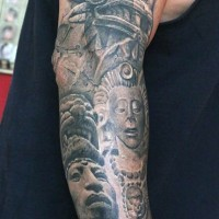 Ancient tribal statues detailed tattoo on sleeve
