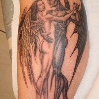 Angel and demon in dance tattoo