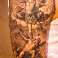 Angel and demons in fight tattoo on the shoulder