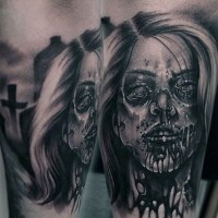 Antic horror movie themed terrifying forearm tattoo of bloody zombie woman in cemetery