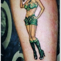 Army girl pin up tattoo on leg