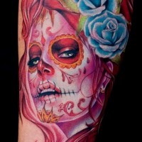 Arrogant day of the dead girl with blue roses in hair forearm tattoo