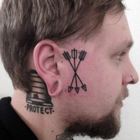 Arrow face tattoo for men