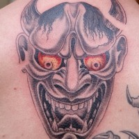 Asian demon with red eyes tattoo by fiesta