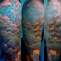 Asian native colorful shoulder tattoo of blue dragon and old temple