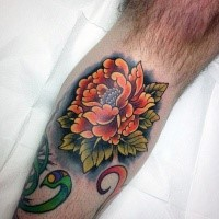 Asian oriental style deep orange flower tattoo with dark shadow under knee