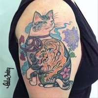 Asian style colored shoulder tattoo of cat stylized with flowers and tiger
