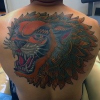 Asian style colored upper back tattoo of large lion head