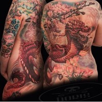 Asian style gorgeous colored whole back tattoo of dragon and blooming tree