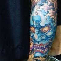 Asian style multicolored female demon tattoo on leg