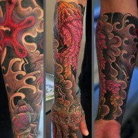 Asian style painted and colored big jellyfish tattoo on arm