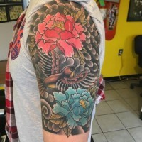 Asian style red and blue peony flowers and flying bird colored half sleeve tattoo