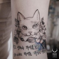 Asian traditional linework style by Zihwa tattoo of cat with lettering and flowers