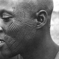 Authentic tribal style homemade tattoo on man's face