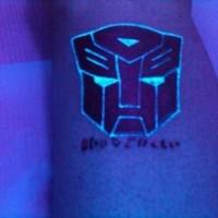 Autobot black light tattoo on the leg