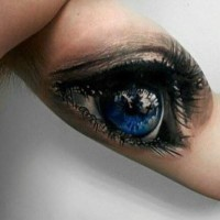 Awesome 3d blue human eye tattoo on arm for men