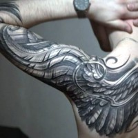 Awesome black and white detailed feather wing tattoo on sleeve and shoulder