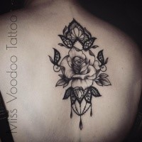 Awesome blackwork style upper back tattoo of rose with floral ornaments by Caro Voodoo