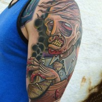 Awesome cartoon like colored zombie monster tattoo on upper arm