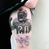 Awesome colored thigh tattoo of American football player