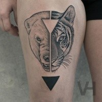 Awesome combined thigh tattoo of split animal heads with triangles by Valentin Hirsch