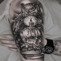 Awesome dotwork style upper arm tattoo of owl with human skull and candle