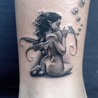 Awesome faerie plays flute tattoo