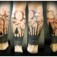 eccezionale luna piena e foresa nera tatuaggio sulla  gamba