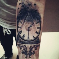 Awesome gray-ink watch and pyramid in clouds tattoo for guys on forearm