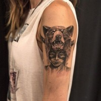 Awesome native american girl with mask bear tattoo on shoulder by Niki Norberg