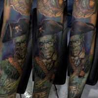 Awesome natural looking colorful forearm tattoo of old zombie pirate