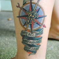 Awesome nautical themed colorful compass tattoo on ankle stylized with lettering