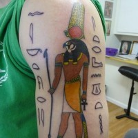 Awesome old school colored Egyptian God tattoo on shoulder with symbols