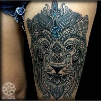 Awesome painted and colored thigh tattoo of lion portrait with jewelry