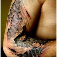 Awesome sacred texts under skin rip tattoo on arm