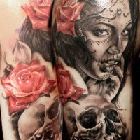 Awesome santa muerte girl with red roses and skull tattoo