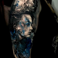 Awesome woman head tattoo on shoulder in black white and blue colors