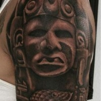 Aztec style black and white old statue tattoo on shoulder