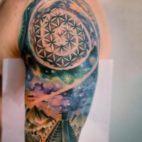 Aztec themed colored spacehalf sleeve tattoo