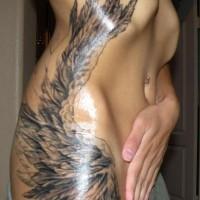 Beautiful angel wing tattoo on ribs for girls